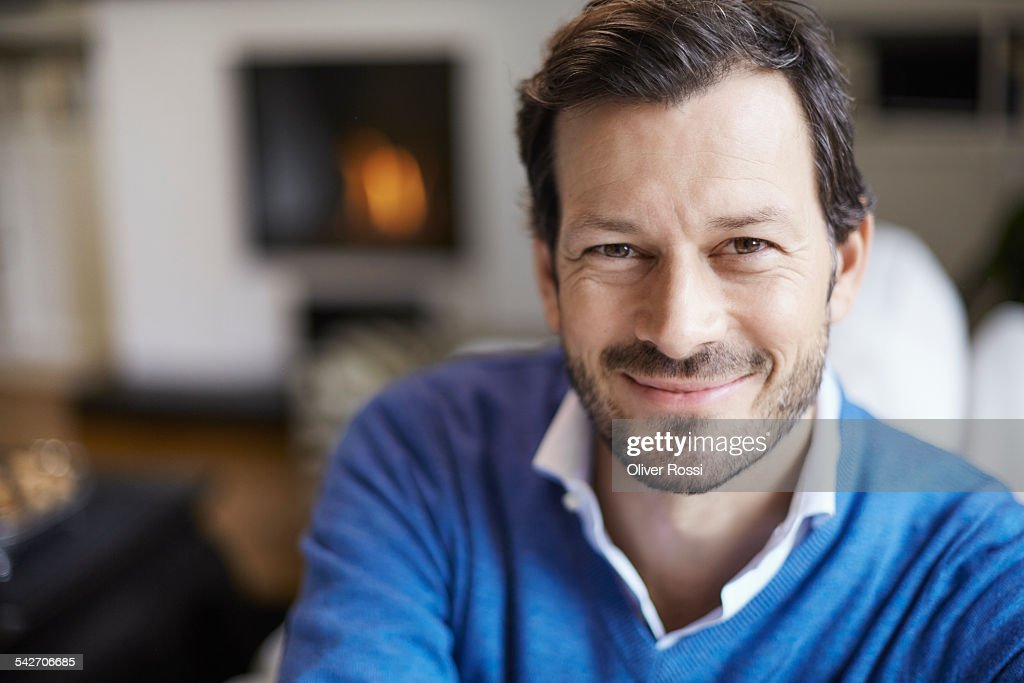 Portrait of smiling man at home : Stock Photo