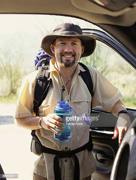 Portrait of smiling man backpacking