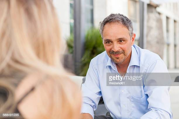 Portrait of smiling man face to face to young woman