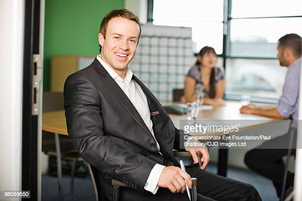 "portrait of smiling man in a conference room - ""compassionate eye"" stock pictures, royalty-free photos & images"