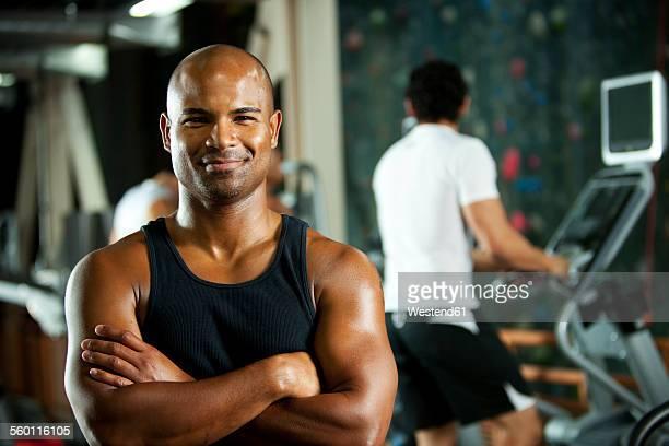 portrait of smiling man in a gym - tank top stock pictures, royalty-free photos & images