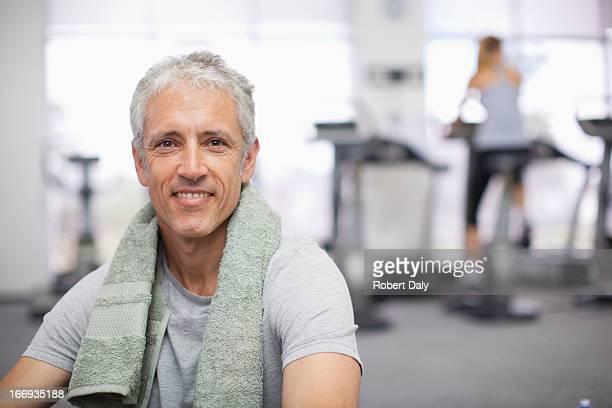 Portrait of smiling man in gymnasium