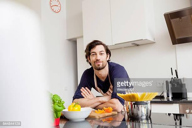 Portrait of smiling man in kitchen