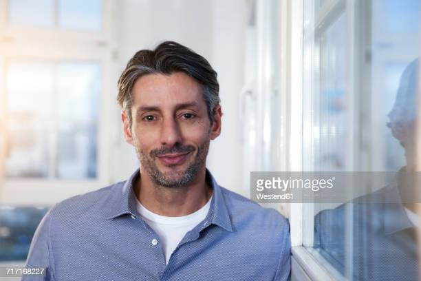 Portrait of smiling man in office