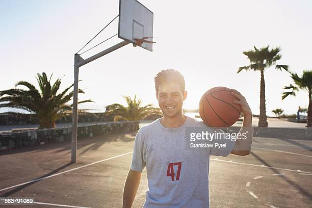 Portrait of smiling man on basketball field