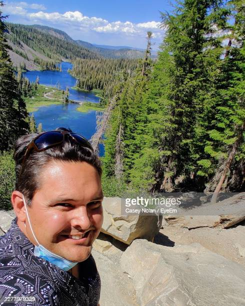 portrait of smiling man on mountain - casey nolan stock pictures, royalty-free photos & images
