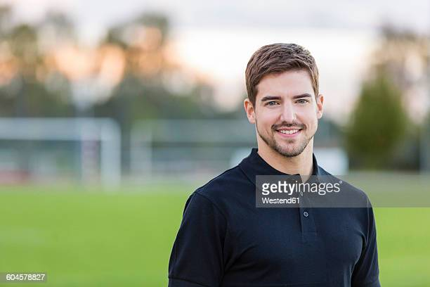 Portrait of smiling man on sports field