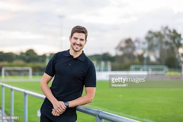 Portrait of smiling man on sports field