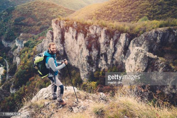 portrait of smiling man on the mountain top - bulgaria stock pictures, royalty-free photos & images