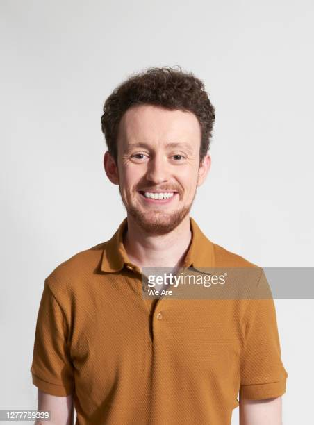 portrait of smiling man - one young man only stock pictures, royalty-free photos & images