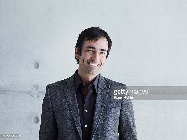 portrait of smiling man - gray jacket stock pictures, royalty-free photos & images