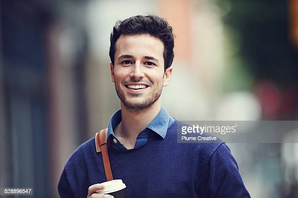 portrait of smiling man - focus on foreground stock pictures, royalty-free photos & images