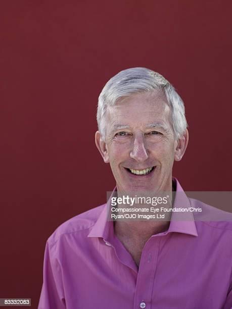 "portrait of smiling man - ""compassionate eye"" fotografías e imágenes de stock"