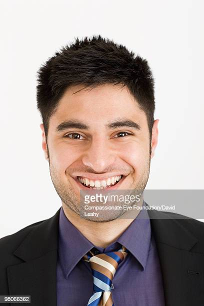 portrait of smiling man - compassionate eye foundation stock pictures, royalty-free photos & images
