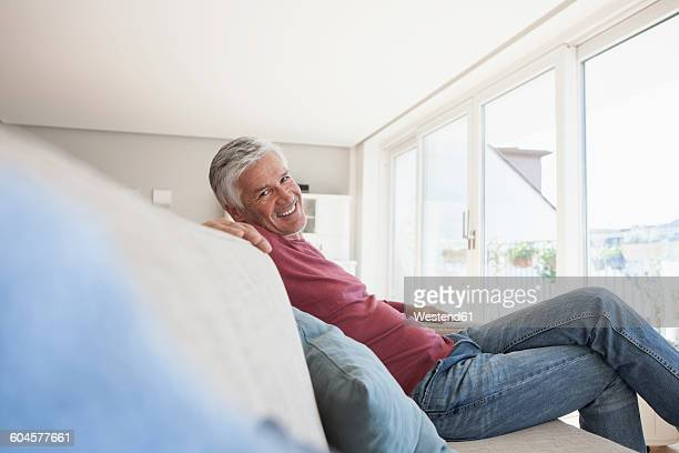 Portrait of smiling man sitting on the couch at home