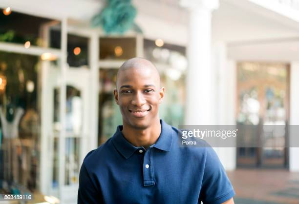 Portrait of smiling man standing in city