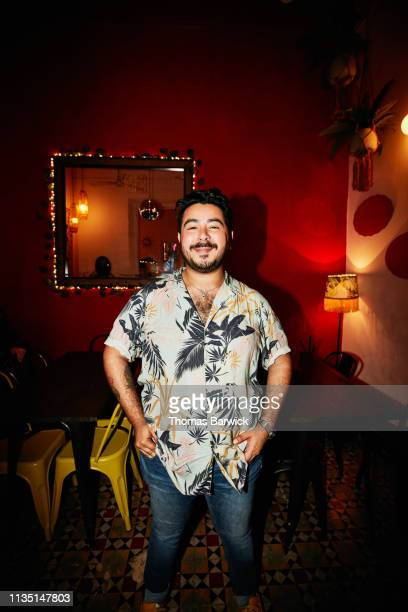 Portrait of smiling man standing in night club