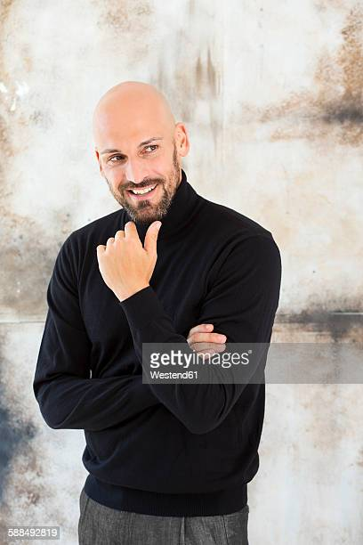 portrait of smiling man wearing black turtleneck - coltrui stockfoto's en -beelden