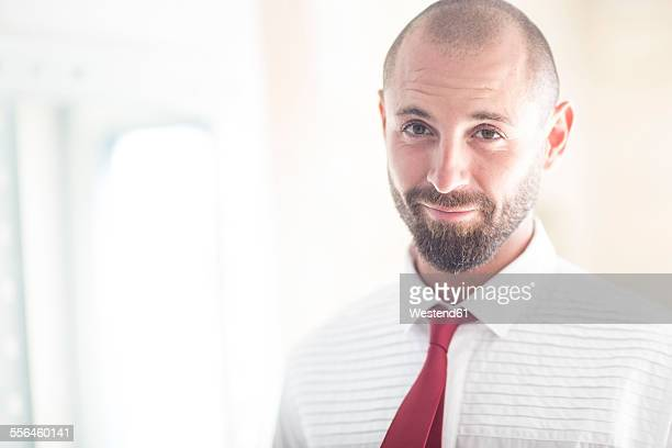 Portrait of smiling man wearing shirt and tie