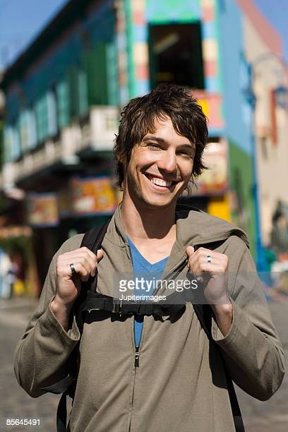 Portrait of smiling man with backpack