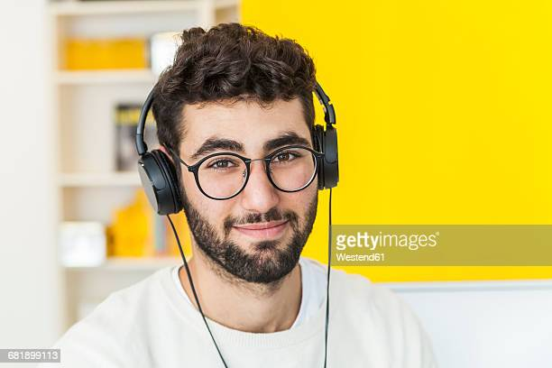 Portrait of smiling man with glasses and headphones