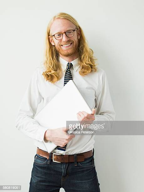 Portrait of smiling man with laptop