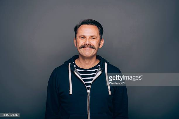 Portrait of smiling man with moustache