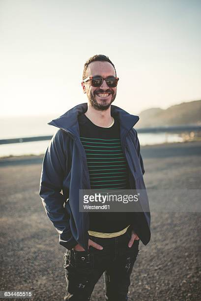 Portrait of smiling man with sunglasses