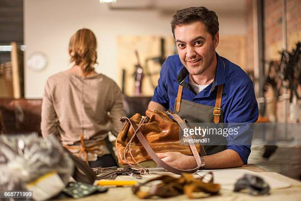 Portrait of smiling man working in leather workshop