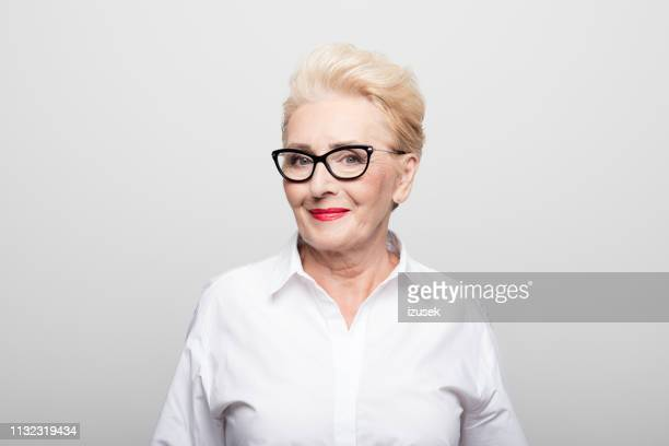 portrait of smiling manager wearing eyeglasses - red lipstick stock pictures, royalty-free photos & images