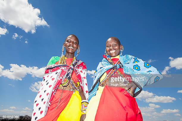 portrait of smiling masai women in traditional clothing - hugh sitton stock pictures, royalty-free photos & images