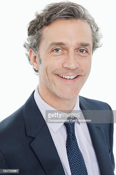 Portrait of smiling mature businessman, close up