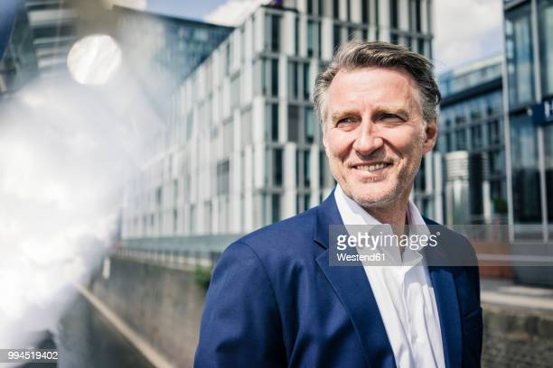 portrait of smiling mature businessman outdoors - anticipation stock pictures, royalty-free photos & images