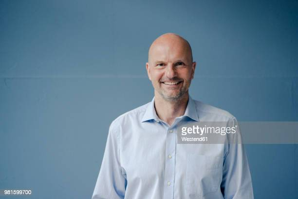 portrait of smiling mature businessman - hair loss stock pictures, royalty-free photos & images