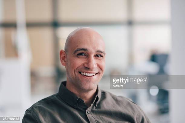 Portrait of smiling mature businessman sitting at office