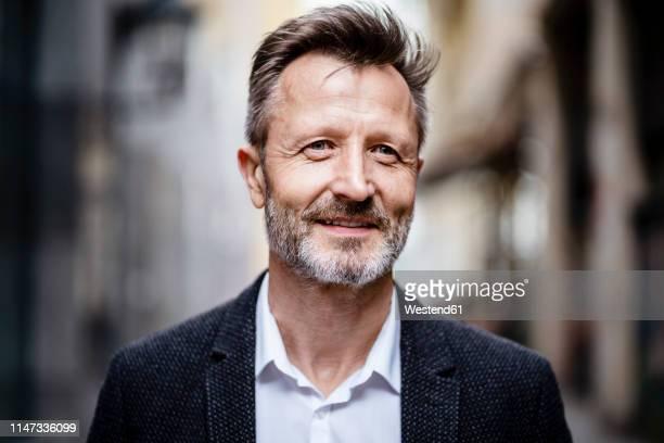 portrait of smiling mature businessman with greying beard - 55 59 anni foto e immagini stock