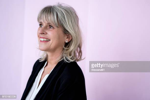Portrait of smiling mature businesswoman looking sideways