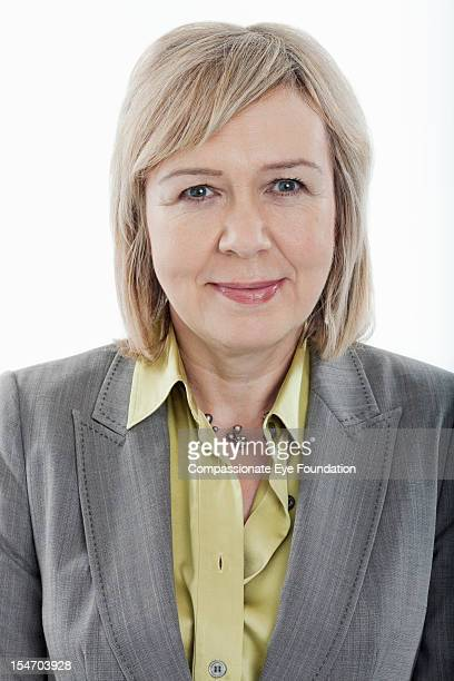 "portrait of smiling mature businesswoman - ""compassionate eye"" stock pictures, royalty-free photos & images"