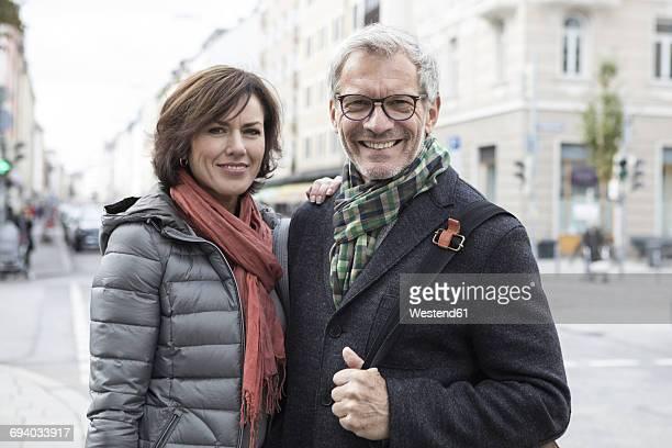 Portrait of smiling mature couple outdoors