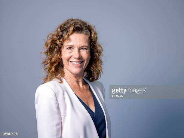 portrait of smiling mature female entrepreneur - 45 49 years stock pictures, royalty-free photos & images