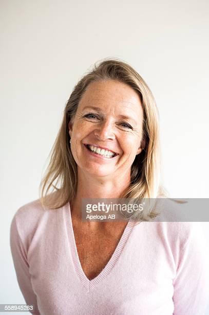 Portrait of smiling mature female teacher in classroom