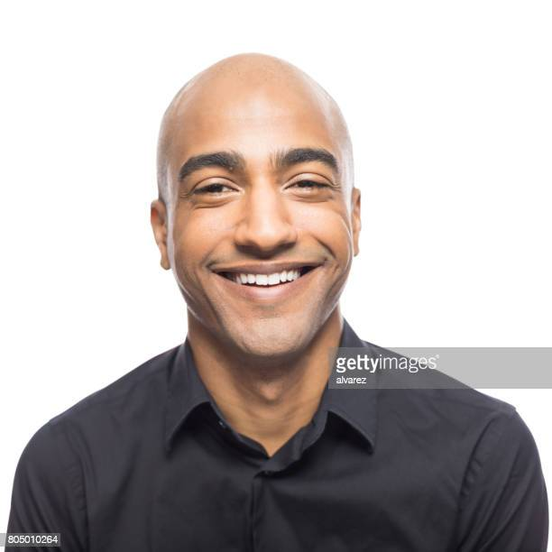 portrait of smiling mature hispanic man - completamente calvo foto e immagini stock