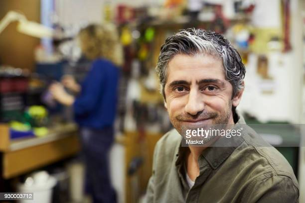 portrait of smiling mature male volunteer at workshop - 45 49 ans photos et images de collection