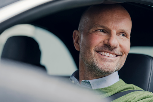 Portrait of smiling mature man in car - gettyimageskorea