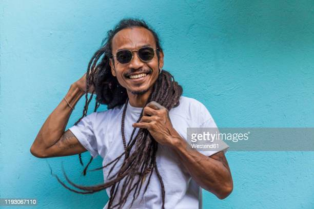 portrait of smiling mature man with dreadlocks - dreadlocks stock pictures, royalty-free photos & images