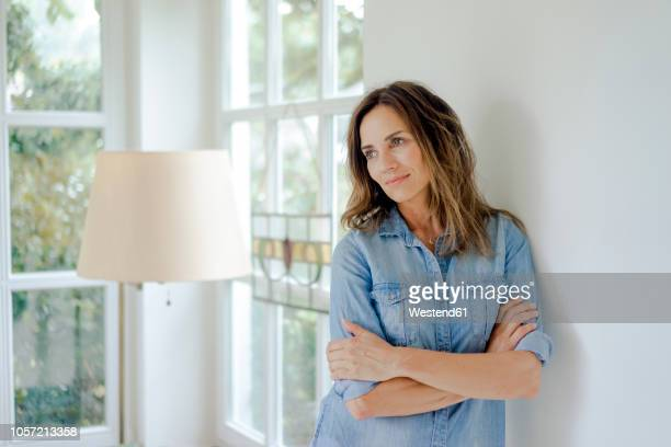 Portrait of smiling mature woman at home