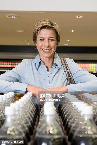 Portrait of smiling mature woman in supermarket