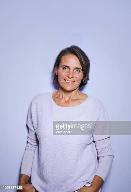 portrait of smiling mature woman - waist up stock pictures, royalty-free photos & images
