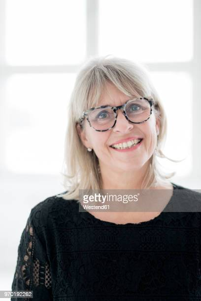 Portrait of smiling mature woman wearing glasses