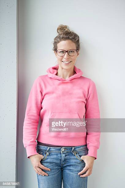 Portrait of smiling mature woman wearing pink hooded jacket